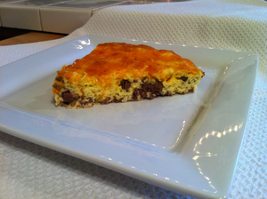 A slice of cheeseburger pie ready to eat.