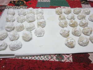 The cookies on the right have one layer of confectioners sugar and the ones on the left have two layers.